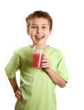 男孩新鲜水果藏品汁液微笑 免版税图库摄影