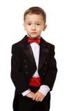 男孩无尾礼服佩带 免版税图库摄影