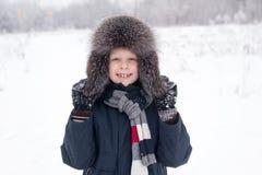 男孩是愉快使用在雪 图库摄影