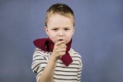 男孩显示一个手指 库存图片