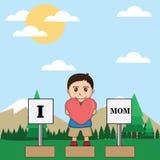 男孩显示他的对母亲的爱 免版税库存图片