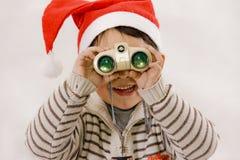 男孩望远镜注意 图库摄影