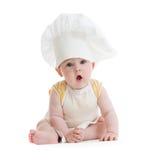 男孩查出一点的厨师帽子 免版税库存图片