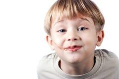 男孩查出的巧克力表面 免版税库存照片