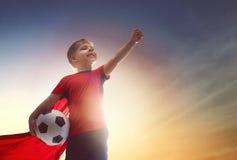 男孩橄榄球使用 库存图片