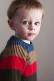 男孩橄榄球毛线衣小孩 库存图片