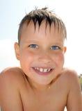 男孩池微笑游泳 库存照片