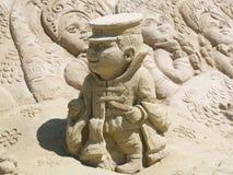 男孩沙子雕塑 图库摄影