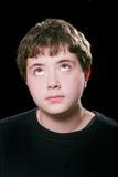 男孩注视青少年的滚 免版税图库摄影