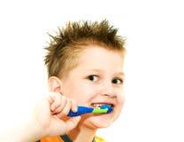 男孩清洁牙 免版税库存图片