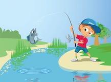 男孩渔在河 库存照片