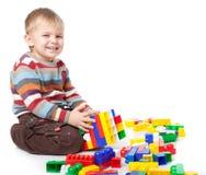 男孩滑稽lego使用 免版税库存图片