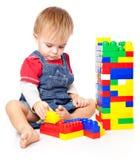 男孩滑稽lego使用 免版税图库摄影