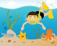 男孩潜水 库存照片