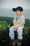 男孩照相机不快乐的一点 免版税库存照片