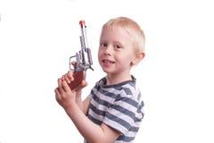 男孩照相机指向武器年轻人的儿童枪 免版税图库摄影