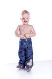 男孩牛仔裤空白的一点 库存照片