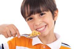 男孩特写镜头剥落微笑的匙子年轻人 免版税库存图片