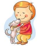 男孩狗他小的宠物 免版税库存图片
