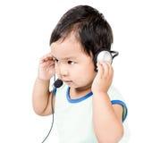 男孩现代耳机 库存图片