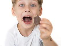 男孩用巧克力 库存图片