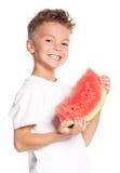 男孩用西瓜 免版税图库摄影