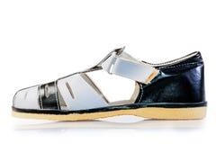 男孩的一只凉鞋 免版税库存照片