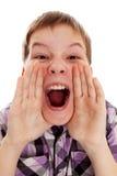 大声尖叫的男孩的特写镜头  免版税库存图片