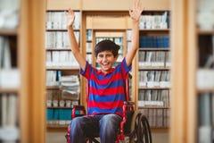 男孩的综合图象轮椅的在学校走廊 免版税图库摄影