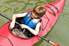 男孩皮船年轻人 图库摄影