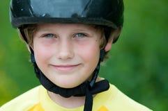 男孩盔甲佩带 免版税图库摄影