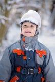 男孩盖帽雪 免版税库存照片