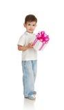 男孩礼品递一点 免版税库存图片