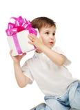 男孩礼品递一点 库存照片