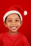 男孩礼服圣诞老人 免版税库存照片