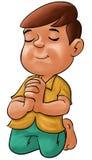 男孩祈祷 库存图片