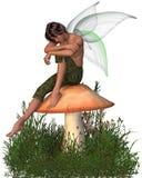 男孩神仙的坐的伞菌 图库摄影