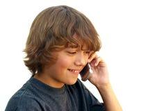 男孩移动电话微笑的联系少年 免版税库存照片