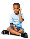 男孩移动电话微笑的联系 库存照片