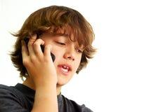 男孩移动电话联系少年 免版税库存图片
