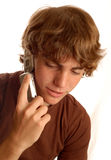 男孩移动电话联系青少年 免版税图库摄影