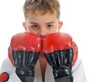 男孩空手道培训年轻人 免版税库存照片