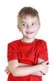男孩立场和微笑,在旁边神色 库存照片