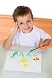 男孩绘画水彩 免版税库存图片