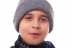 男孩给冬天穿衣 图库摄影