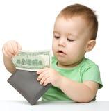 男孩美元使用的一点 免版税库存照片