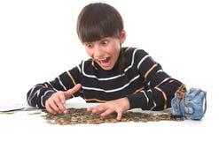 男孩考虑货币 免版税图库摄影