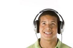 男孩耳机听的音乐少年 库存图片