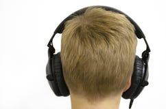 男孩耳机 图库摄影