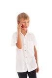男孩联系在移动电话 库存照片